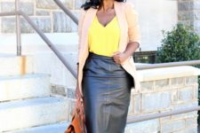 08 a bold yellow top, a black leather skirt, a tan blazerm a brown bag and black shoes