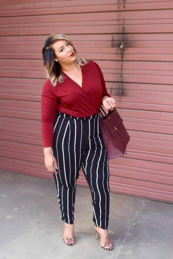 a burgundy shirt, striped pants, heels and a plum-colored bag for a touch of color