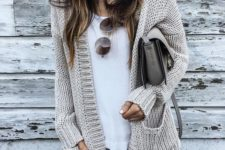 08 a cozy neutral cardigan, ripped jeans, a white tee, a grey bag