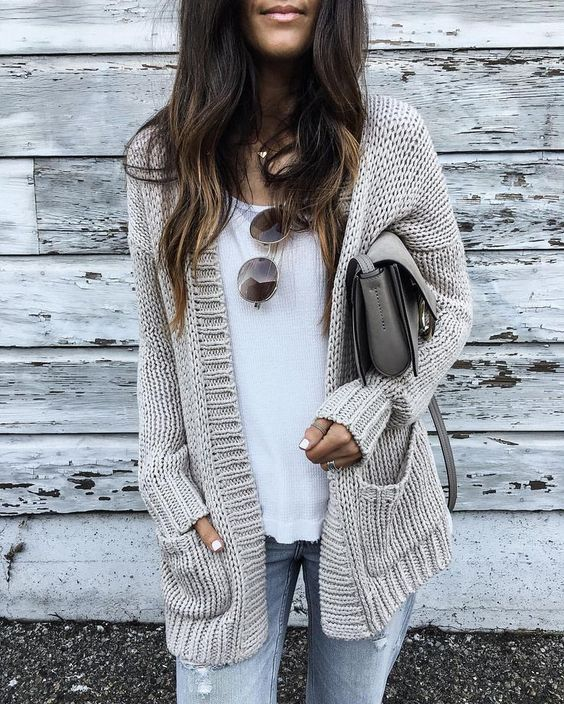 a cozy neutral cardigan, ripped jeans, a white tee, a grey bag