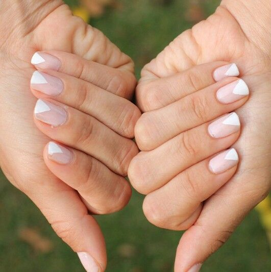 a geometric take on the French manicure done in the traditional shades