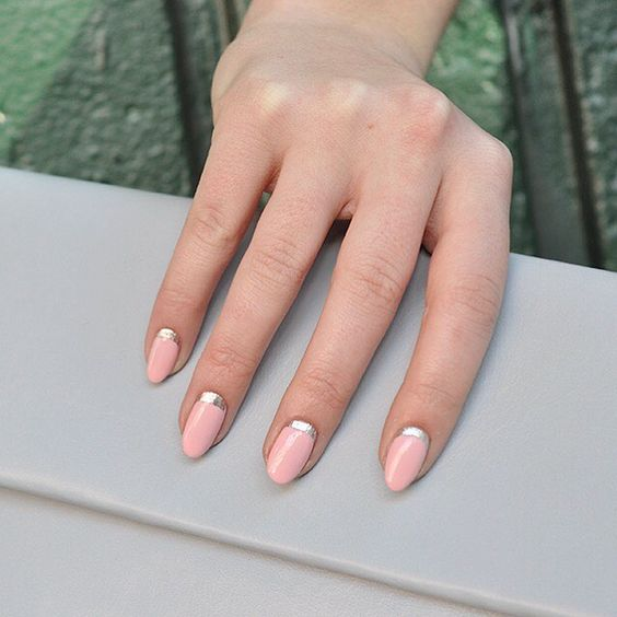a pink manicure with silver half moons is a chic work-appropriate idea to try