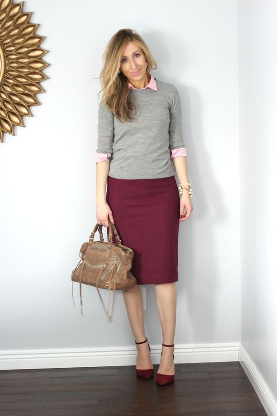 a plum-colored pencil skirt and shoes, a pink shirt, a grey top and a brown bag