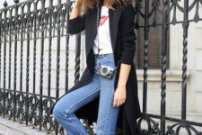 08 a white logo t-shirt, blue jeans, a black trench and black booties