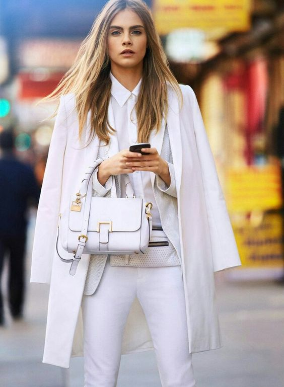 a work outfit with a white pantsuit, a white shirt and a white long blazer plus a bag