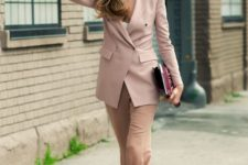 08 camel pants, a white top, a dusty pink blazer,  muted green shoes and a plum-colored clutch