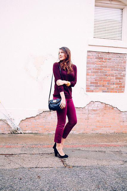 a berry-hued look with a plum-colored top, fuchsia cropped pants, black shoes and a bag
