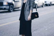 09 a black slip dress, black boots, a plaid jacket and a black bag