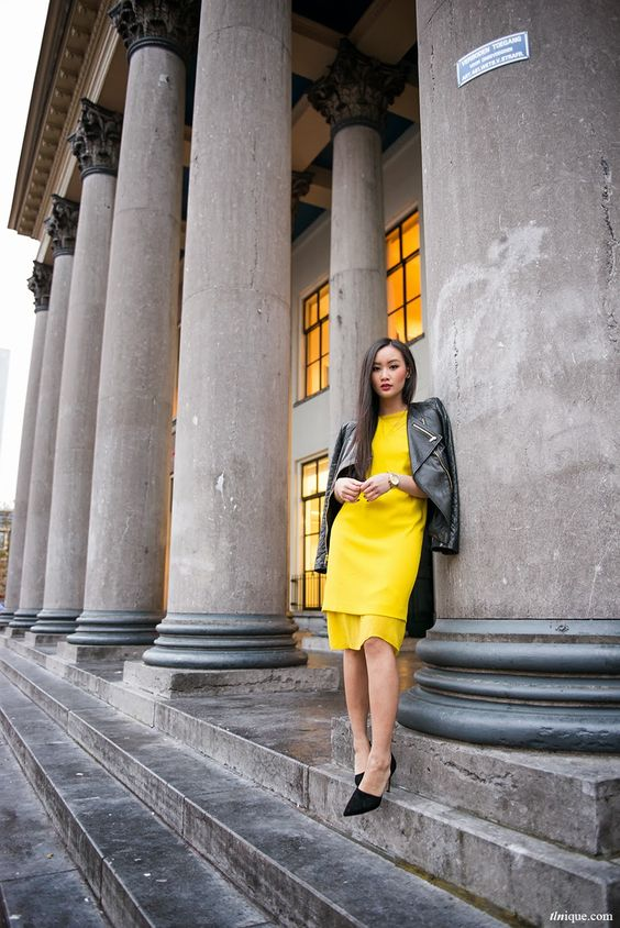 a bold yellow dress, black shoes and a black leather jacket for a statement