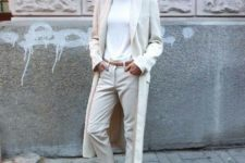09 a chic casual look with white sneakers and a turtleneck and off-white pants and a trench