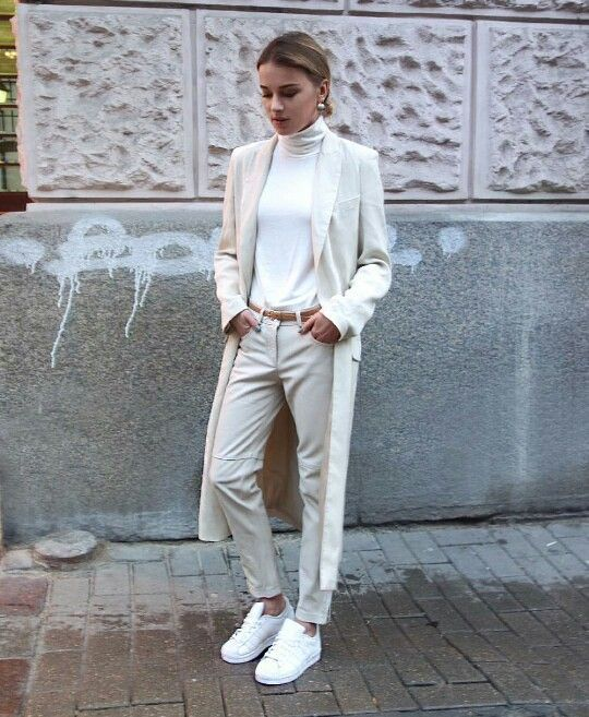 a chic casual look with white sneakers and a turtleneck and off-white pants and a trench