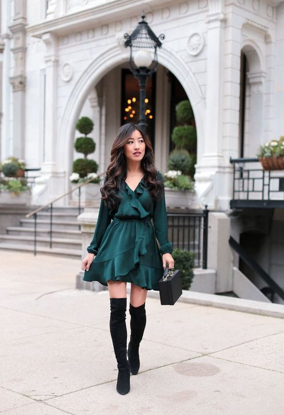 a fall date night outfit with a forest green ruffled wrap dress, black velvet boots and a bag