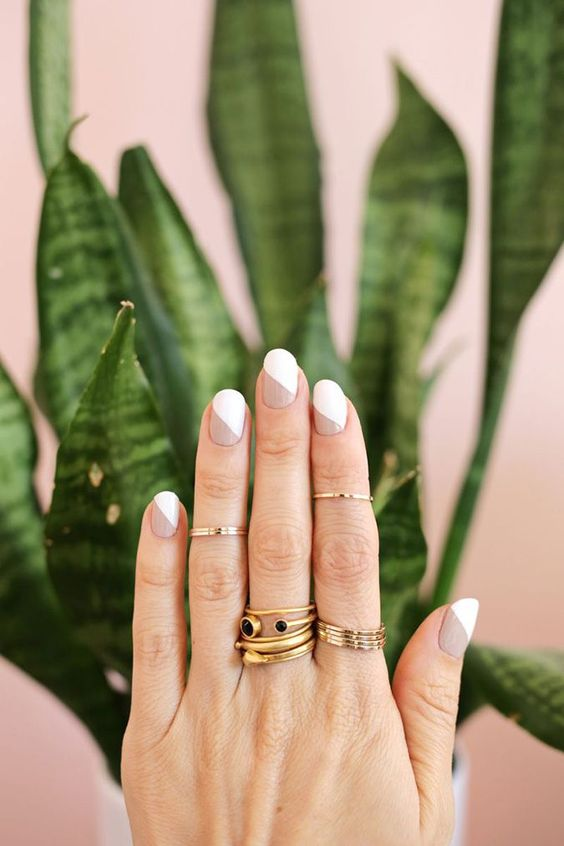 a fresh and modern take on a traditional French manicure with nude and white and a bit of geometry