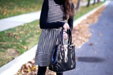 09 a striped sleeveless over the knee dress, a black top, tights and boots