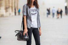 09 black denim, a printed tee, a grey shirt, combat boots and a black comfy bag