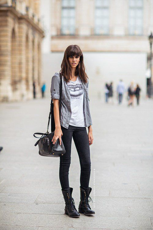 black denim, a printed tee, a grey shirt, combat boots and a black comfy bag