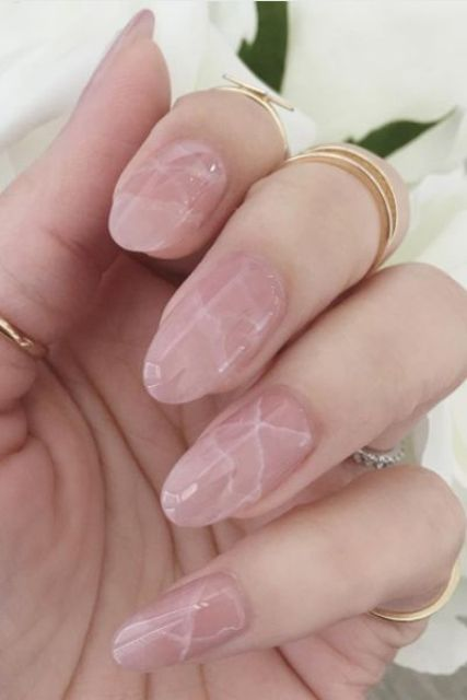 nude marble nails with an almond shape is a hot and trendy choice