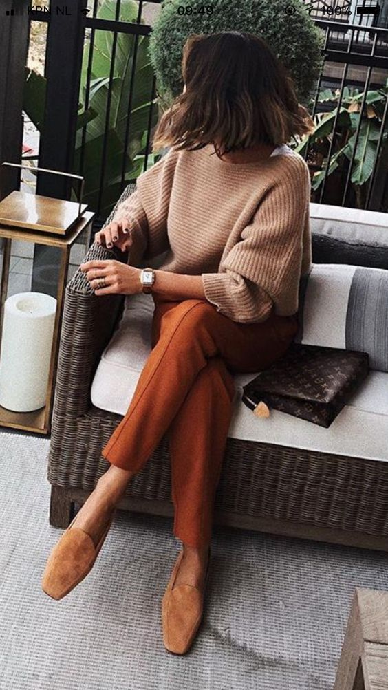 rust pants, camel flats, a neutral sweater and a brown bag for a relaxed work look