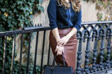 10 a black top with lace, a brown midi pencil skirt, black studded shoes and a black bag