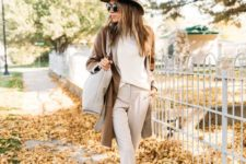 10 a creamy top, pants and booties, a camel cardigan, a brown hat and a creamy bag