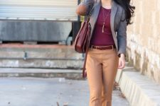 10 a plum-colored top, tan-colored pants, plum-colored shoes and a grey blazer