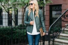 10 a white shirt, a grene leather jacket, blue denim and strappy brown shoes