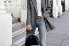 10 a white tee, a grey oversized blazer, blue jeans with a raw hem and a black bag