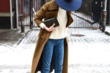 10 black boots, blue denim, a creamy sweater, a brown coat and a navy hat