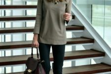 10 black pants, an olive green top, a plum-colored bag and a statement necklace
