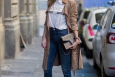 10 blue denim, a logo t-shirt, a tan trench, red shoes and a bag