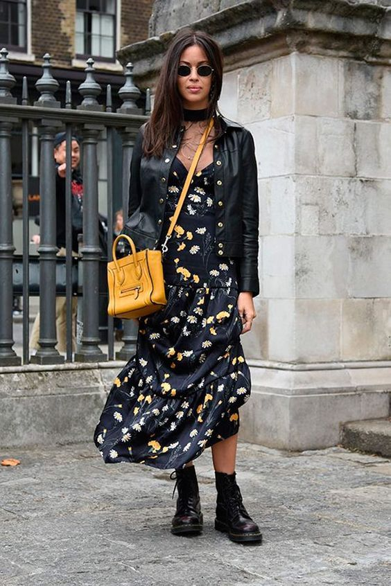 a black floral midi dress, a black leather jacket and black combat boots plus a yellow bag
