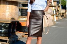 11 a blue shirt, a statement necklace, a brown leather skirt, nude shoes and a matching bag