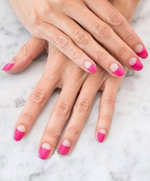 a bold and colorful take on French nails with long pink tips