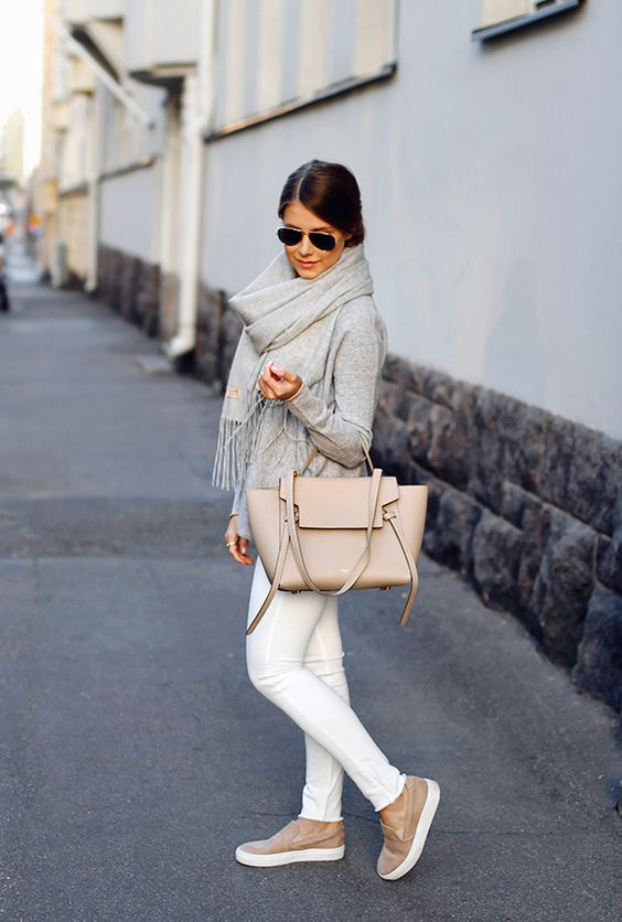 a grey long sleeve, white jeans, a grey scarf, a blush bag and slipons