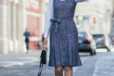 11 a grey sleeveless sheath dress, a white shirt, black T-strap shoes
