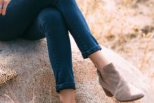 11 a mustard turtleneck, blue jeans and grey suede booties for the fall