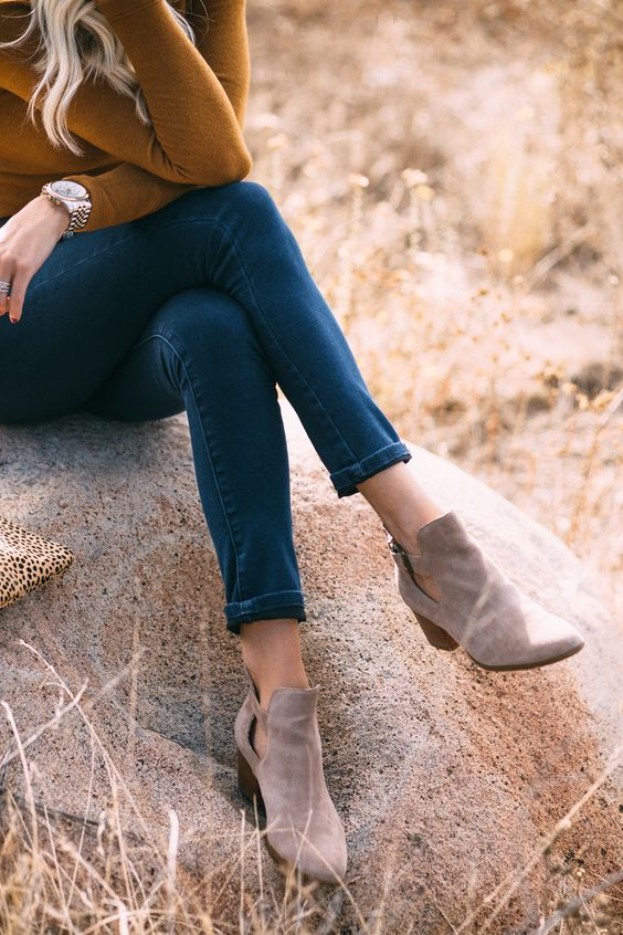 a mustard turtleneck, blue jeans and grey suede booties for the fall