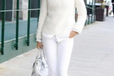 11 a white shirt and pants, a creamy sweater, a white bag and white and navy shoes