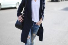 11 a white tee, a navy striped long cardigan, black boots