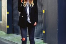 11 navy ripped jeans, black strappy heels a striped top, a black blazer and a fedora hat