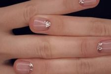 11 nude nails with a touch of copper glitter at the cuticle to shine