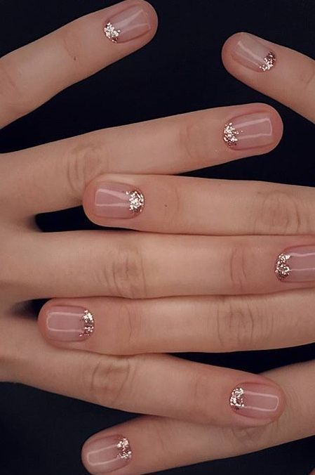 nude nails with a touch of copper glitter at the cuticle to shine