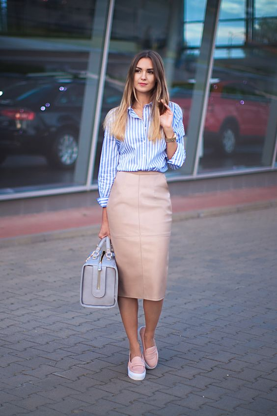 a blush leather midi skirt, a striped blue and white shirt, pink slipons and a grey bag