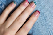 12 a colorful and mismatching French manicure with green and pink tips