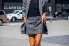 12 a grey checked suit with a mini skirt and an oversized blazer, a black tee and fuchsia sock boots