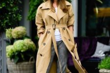 12 an oversized tan trench is styled with printed pants, a white tee and brown shoes