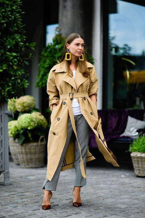 an oversized tan trench is styled with printed pants, a white tee and brown shoes
