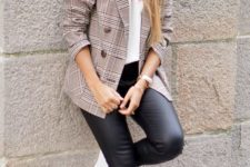 12 black leather pants, white sneakers, a white logo tee and a checked jacket