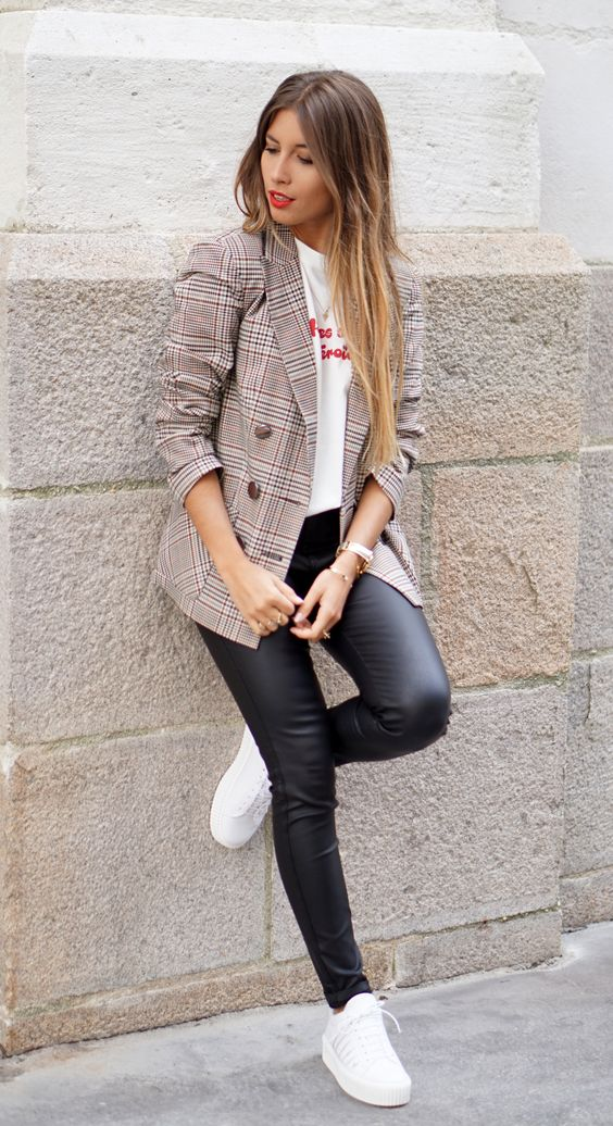 black leather pants, white sneakers, a white logo tee and a checked jacket