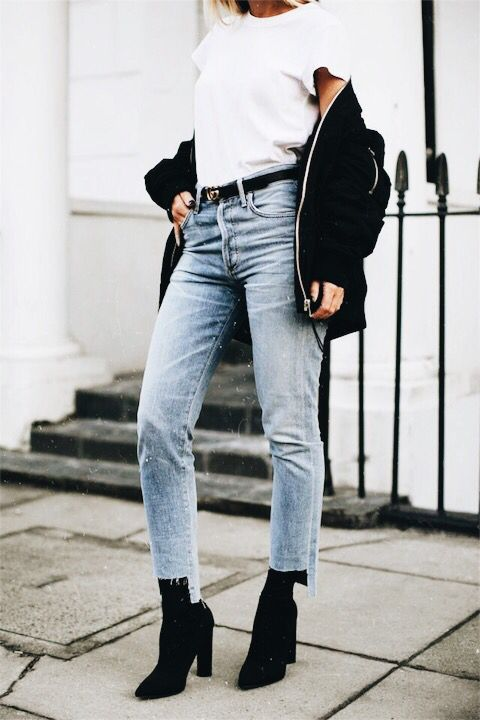 cropped blue jeans with a raw hem can be styled with boots for the fall